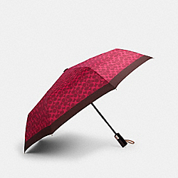 UMBRELLA IN FUN SIGNATURE PRINT - MAGENTA - COACH 91361