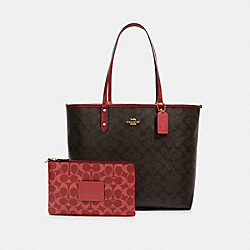 REVERSIBLE CITY TOTE IN BLOCKED SIGNATURE CANVAS - IM/BROWN MULTI - COACH 91381