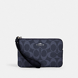 CORNER ZIP WRISTLET IN SIGNATURE CANVAS - SV/DENIM MIDNIGHT - COACH 92632