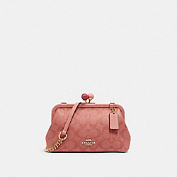 NORA KISSLOCK CROSSBODY IN SIGNATURE CANVAS - IM/CANDY PINK - COACH C1452