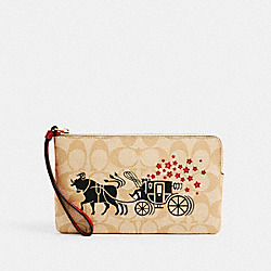 LUNAR NEW YEAR LARGE CORNER ZIP WRISTLET IN SIGNATURE CANVAS WITH OX AND CARRIAGE - IM/LIGHT KHAKI MULTI - COACH C2259
