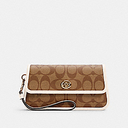 COACH ORIGINALS WRISTLET IN SIGNATURE CANVAS - IM/KHAKI/CHALK - COACH C2299