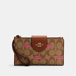 TECH WALLET IN SIGNATURE CANVAS WITH LIPS PRINT - IM/KHAKI REDWOOD - COACH C2873