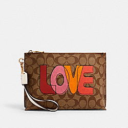 ROWAN POUCH IN SIGNATURE CANVAS WITH LOVE PRINT - IM/KHAKI CHALK MULTI - COACH C2890