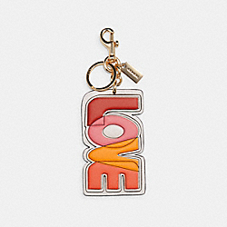 LOVE BAG CHARM IN SIGNATURE CANVAS - IM/RED MULTI KHAKI - COACH C3112