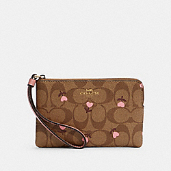 CORNER ZIP WRISTLET IN SIGNATURE CANVAS WITH HEART FLORAL PRINT - IM/KHAKI RED MULTI - COACH C3301