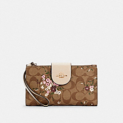 TECH PHONE WALLET IN SIGNATURE CANVAS WITH EVERGREEN FLORAL PRINT - IM/KHAKI MULTI - COACH C3722