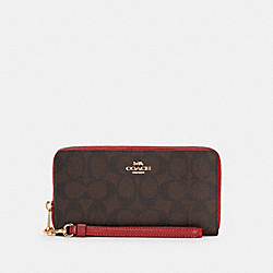 LONG ZIP AROUND WALLET IN SIGNATURE CANVAS - IM/BROWN 1941 RED - COACH C4452