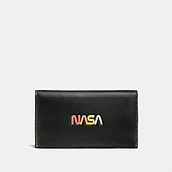 PHONE WALLET WITH EMBOSSED SPACE - BLACK - COACH F10467