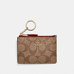 MINI SKINNY ID CASE IN SIGNATURE CANVAS - KHAKI/CHERRY/LIGHT GOLD - COACH F16107
