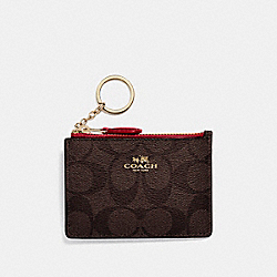 COACH MINI SKINNY ID CASE - LIGHT GOLD/BROWN - F16107