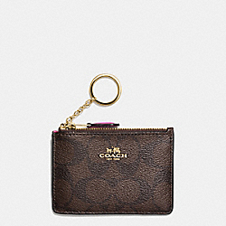 COACH MINI SKINNY ID CASE IN SIGNATURE COATED CANVAS - IMITATION GOLD/BROWN - F16107