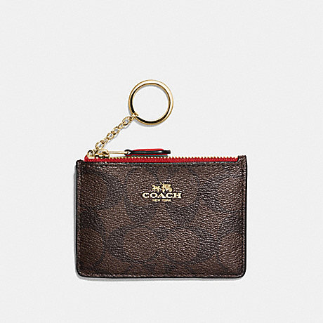 COACH MINI SKINNY ID CASE IN SIGNATURE CANVAS - BROWN/RUBY/IMITATION GOLD - F16107