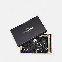 COACH BOXED SMALL WRISTLET WITH GLITTER STAR PRINT - SILVER/BLACK - F22705