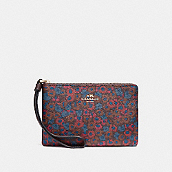 CORNER ZIP WRISTLET WITH MEADOW CLUSTER PRINT - IMFCG - COACH F23637