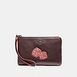 CORNER ZIP WRISTLET WITH DICE MOTIF - BLACK ANTIQUE NICKEL/OXBLOOD 1 - COACH F23649