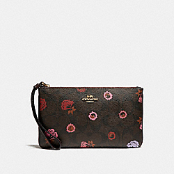 COACH LARGE WRISTLET WITH PRIMROSE FLORAL SIGNATURE PRINT - IMBMC - F24393