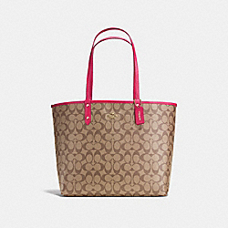 COACH REVERSIBLE CITY TOTE IN SIGNATURE CANVAS - Khaki/Bright Pink/Light Gold - F25033
