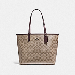 REVERSIBLE CITY TOTE IN SIGNATURE CANVAS - PLATINUM/OXBLOOD/SILVER - COACH F25849