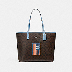 COACH REVERSIBLE CITY TOTE IN SIGNATURE CANVAS WITH FLAG - BROWN BLACK/BLACK/BLACK ANTIQUE NICKEL - F25949