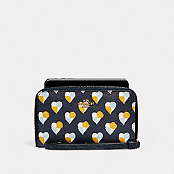 PHONE WALLET WITH CHECKER HEART PRINT - MIDNIGHT MULTI/LIGHT GOLD - COACH F25963
