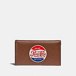 UNIVERSAL PHONE CASE WITH PEPSI® MOTIF - SADDLE - COACH F26084