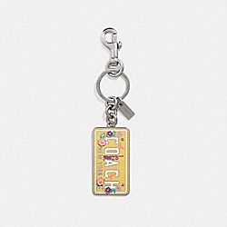 COACH LICENSE PLATE BAG CHARM - SILVER/CANARY - COACH F26575