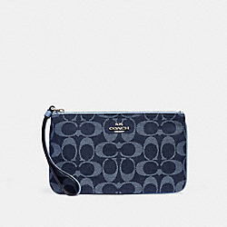 COACH LARGE WRISTLET IN SIGNATURE JACQUARD - SILVER/DENIM - F26660