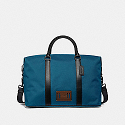 COACH VOYAGER BAG IN CORDURA - DENIM/BLACK ANTIQUE NICKEL - F27610
