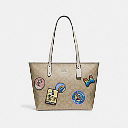 CITY ZIP TOTE IN SIGNATURE CANVAS WITH MINNIE MOUSE PATCHES - SILVER/LIGHT KHAKI/CHALK - COACH F29358