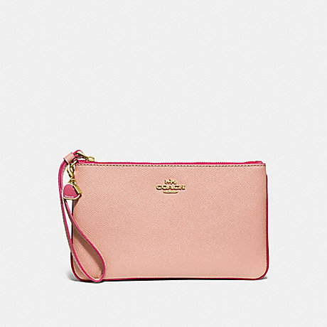 COACH LARGE WRISTLET WITH CHARMS - nude pink/imitation gold - f29398