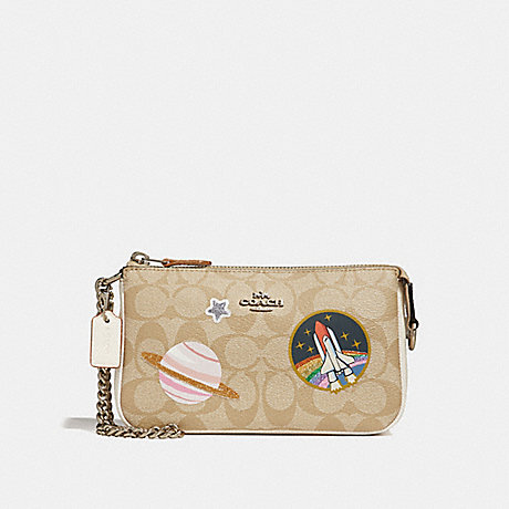 COACH LARGE WRISTLET 19 IN SIGNATURE CANVAS WITH SPACE PATCHES - SILVER/LIGHT KHAKI/CHALK - f29403