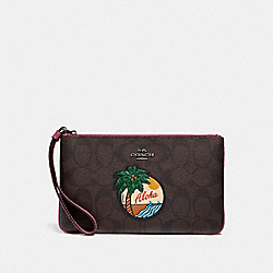 LARGE WRISTLET IN SIGNATURE CANVAS WITH ALOHA MOTIF - BROWN/BLACK/BLACK ANTIQUE NICKEL - COACH F29418