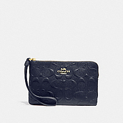 CORNER ZIP WRISTLET IN SIGNATURE LEATHER - MIDNIGHT/IMITATION GOLD - COACH F30049