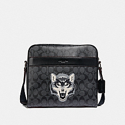 CHARLES CAMERA BAG IN SIGNATURE CANVAS WITH WOLF MOTIF - BLACK MULTI/BLACK ANTIQUE NICKEL - COACH F31337