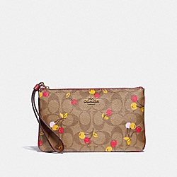 LARGE WRISTLET IN SIGNATURE CANVAS WITH CHERRY PRINT - KHAKI MULTI /LIGHT GOLD - COACH F31896