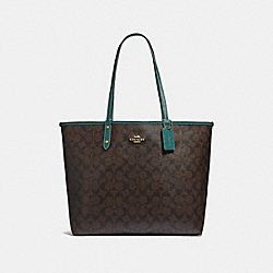 COACH REVERSIBLE CITY TOTE IN SIGNATURE CANVAS - BROWN/DARK TURQUOISE/LIGHT GOLD - F32192