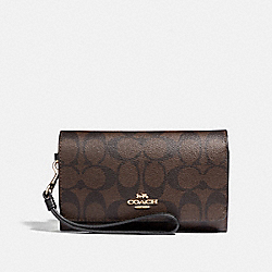 COACH FLAP PHONE WALLET IN SIGNATURE CANVAS - BROWN/BLACK/LIGHT GOLD - F32484