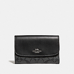 COACH MEDIUM ENVELOPE WALLET IN SIGNATURE CANVAS - BLACK SMOKE/BLACK/SILVER - F32485