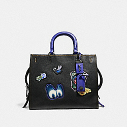 DISNEY X COACH ROGUE WITH PATCHES - BLACK/BLACK COPPER - COACH F32793