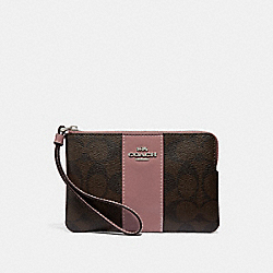 CORNER ZIP WRISTLET IN SIGNATURE CANVAS - BROWN/DUSTY ROSE/SILVER - COACH F34650