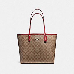 REVERSIBLE CITY TOTE IN SIGNATURE CANVAS - KHAKI/CHERRY/LIGHT GOLD - COACH F36658