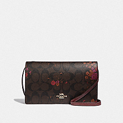 HAYDEN FOLDOVER CROSSBODY CLUTCH IN SIGNATURE CANVAS WITH FLORAL BUNDLE PRINT - BROWN/METALLIC CURRANT/LIGHT GOLD - COACH F38715