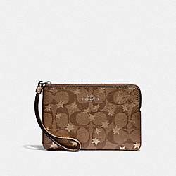 CORNER ZIP WRISTLET IN SIGNATURE CANVAS WITH POP STAR PRINT - KHAKI MULTI /SILVER - COACH F39045