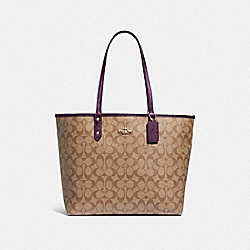 REVERSIBLE CITY TOTE IN SIGNATURE CANVAS - KHAKI/METALLIC RASPBERRY/LIGHT GOLD - COACH F39518