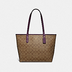 CITY ZIP TOTE IN SIGNATURE CANVAS - KHAKI/METALLIC RASPBERRY/LIGHT GOLD - COACH F39523