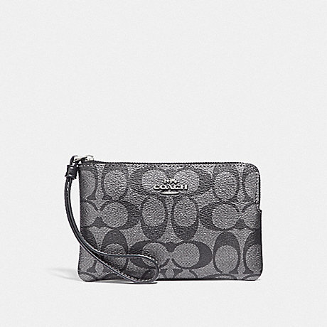 COACH CORNER ZIP WRISTLET IN SIGNATURE CANVAS - GUNMETAL/SILVER - F39669