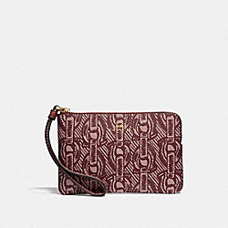 CORNER ZIP WRISTLET WITH CHAIN PRINT - CLARET/LIGHT GOLD - COACH F40113