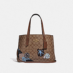 KEITH HARING AVENUE CARRYALL IN SIGNATURE CANVAS WITH PATCHES - KHAKI MULTI /IMITATION GOLD - COACH F48722