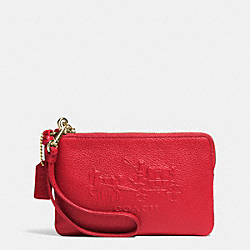 COACH EMBOSSED HORSE AND CARRIAGE SMALL ZIP WRISTLET IN LEATHER - LIGHT GOLD/RED - F52500